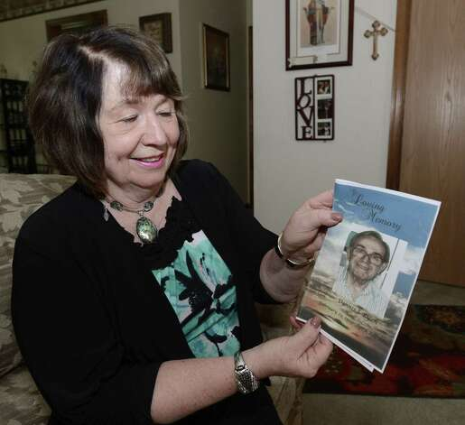 Jeanne Ryan holds an image of her father at her home in Schenectady, N.Y. May 31, 2012.       (Skip Dickstein / Times Union) Photo: Skip Dickstein / 00017877A
