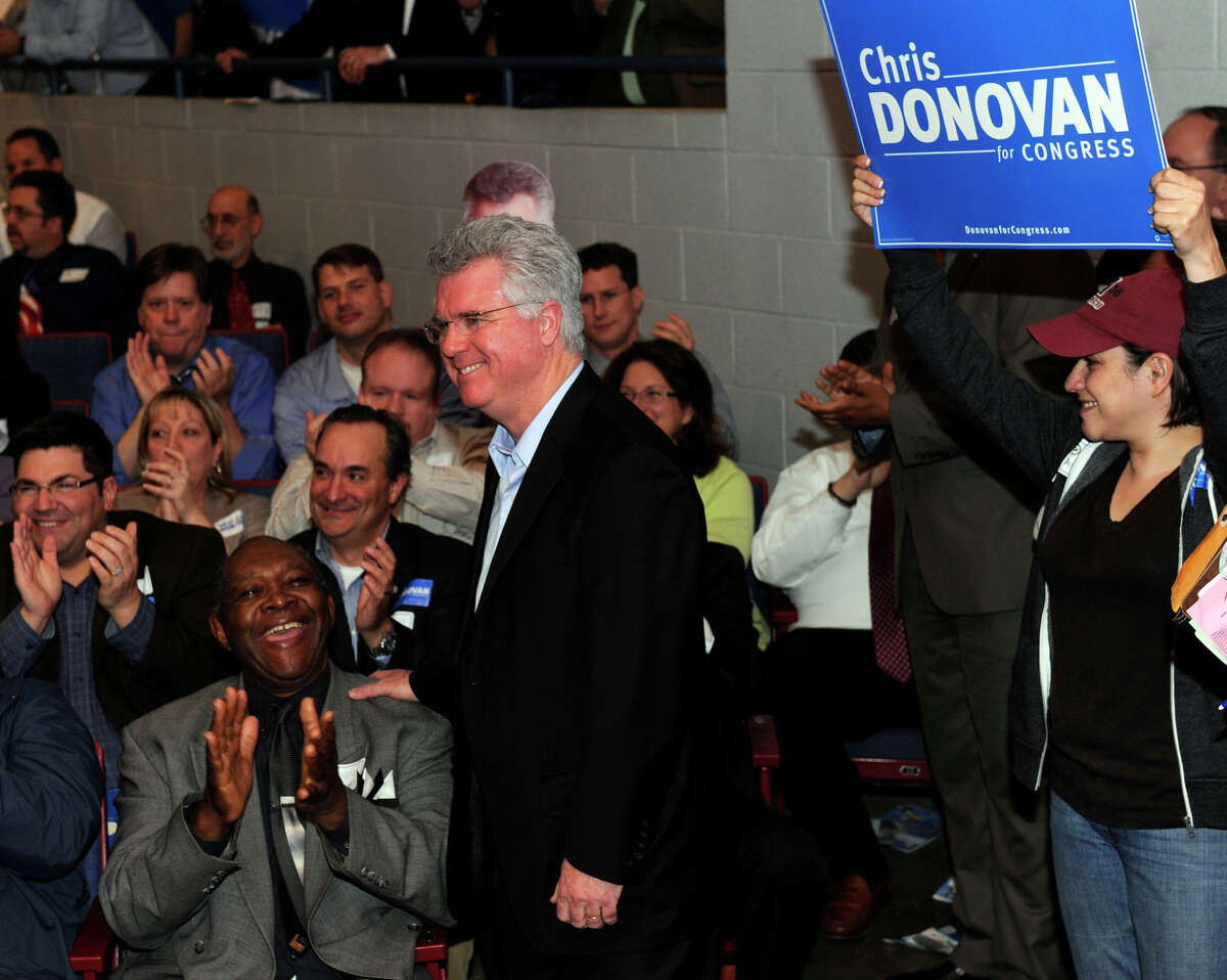 House Speaker Chris Donovan, center, listens as delegates cast their votes for the Democratic convention for the 5th congressional district Monday in Waterbury, May 14, 2012.