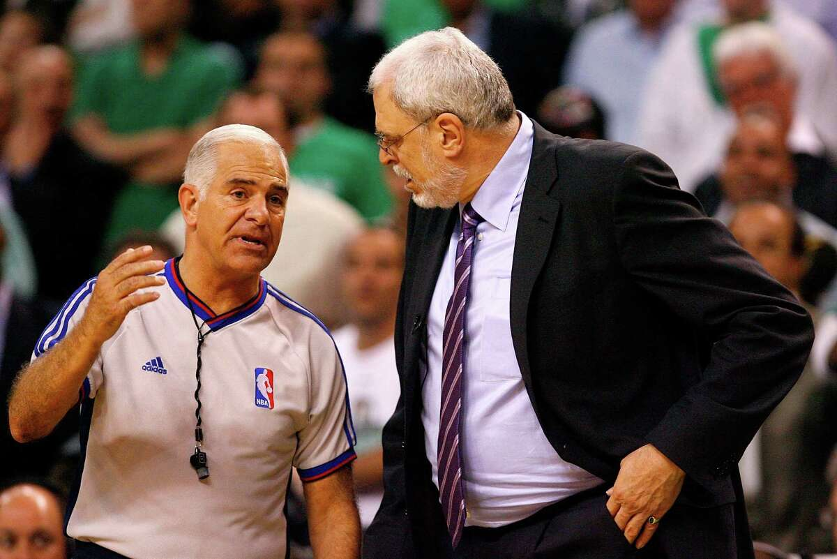 BOSTON - JUNE 17: Referee Bennett Salvatore explains a call to head coach Phil Jackson of the Los Angeles Lakers in the game against the Boston Celtics during Game Six of the 2008 NBA Finals on June 17, 2008 at TD Banknorth Garden in Boston, Massachusetts. The Celtics defeated the Lakers 131-92 to win the NBA Championship. NOTE TO USER: User expressly acknowledges and agrees that, by downloading and/or using this Photograph, user is consenting to the terms and conditions of the Getty Images License Agreement. (Photo by Jim Rogash/Getty Images)