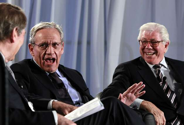 Moderator Charlie Rose, left, listens as former Washington Post reporters Bob Woodward, and Carl Bernstein, speak during an event sponsored by The Washington Post to commemorate the 40th anniversary of Watergate Monday, June 11, 2012 at the Watergate office building in Washington. (AP Photo/Alex Brandon) Photo: Alex Brandon, Associated Press