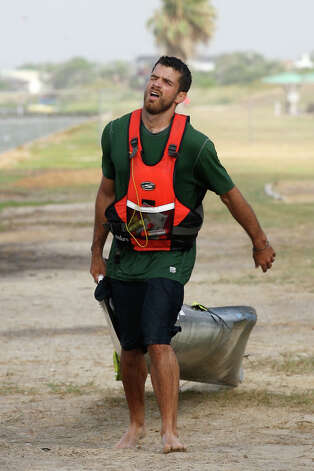 Andrew Condie drags his canoe the last quarter mile after getting out of the San Antonio Bay during the during the 2012 Texas Water Safari canoe race, Monday, June 11, 2012. Allowed by rules, Condie was able to cross the finish line with his craft and place 12th overall. Photo: Jerry Lara, San Antonio Express-News / © 2012 San Antonio Express-News