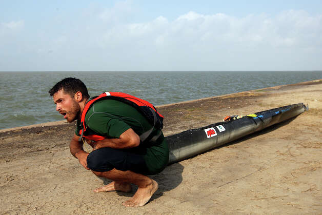 Exhausted, Andrew Condie, of Cuero, takes a breather while dragging his canoe the last quarter mile after getting out of the San Antonio Bay during the during the 2012 Texas Water Safari canoe race, Monday, June 11, 2012. Allowed by rules, Condie was able to cross the finish line with his craft and place 12th overall. Photo: Jerry Lara, San Antonio Express-News / © 2012 San Antonio Express-News