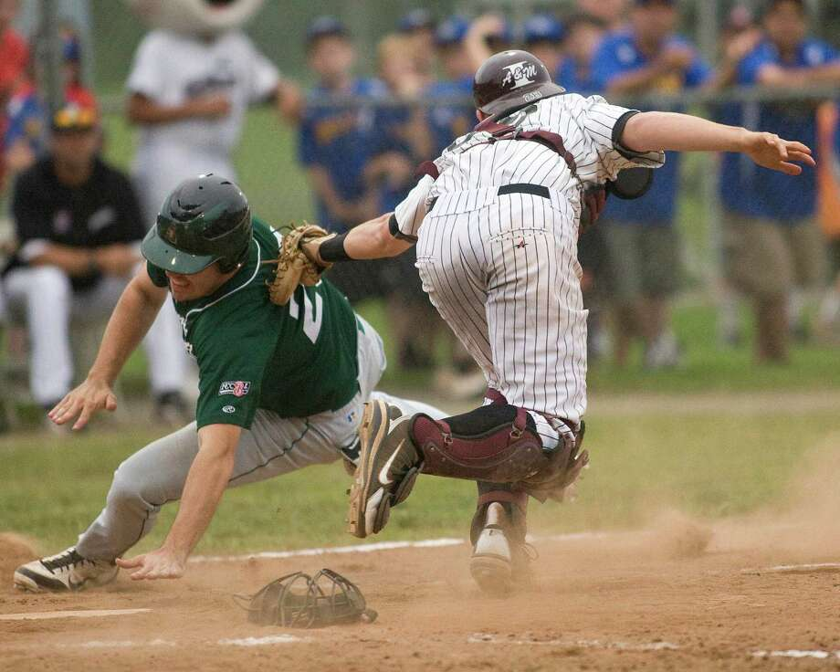 Westerners' catcher Sean Smedley tags out Vermont's Rob Kelly at home plate Monday night at Rogers Park. Photo: Barry Horn / The News-Times Freelance