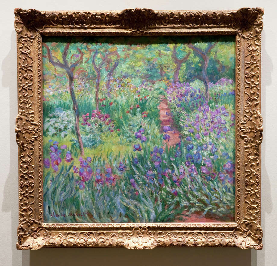 "Claude Monet's ""The Artist's Garden in Giverny,"" an oil on canvas from 1900, is one of two paintings featured in ""Monet's Garden"" at the New York Botanical Garden. The paining is from the Yale University Art Gallery in New Haven. Photo: Contributed Photo"