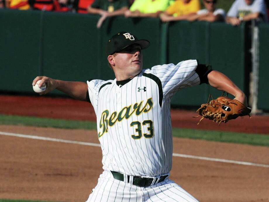 Baylor starting pitcher Tyler Bremer throws against Arkansas during an NCAA college baseball tournament super regional game, Monday, June 11, 2012, in Waco, Texas. (AP Photo/Waco Tribune Herald, Rod Aydelotte) Photo: Rod Aydelotte, Associated Press / Waco Tribune Herald