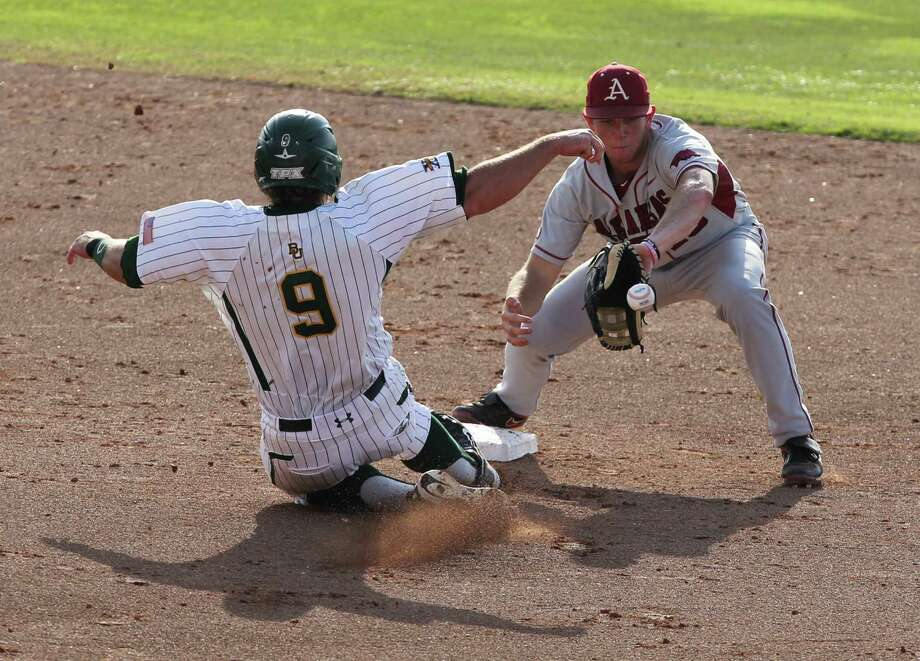 Arkansas' Tim Carver, right, tags out Baylor Max Muncy (9) in the second inning of an NCAA college baseball tournament super regional game, Monday,  June 11, 2012, in Waco, Texas. (AP Photo/Waco Tribune Herald, Jerry Larson) Photo: Jerry Larson, Associated Press / Waco Tribune Herald