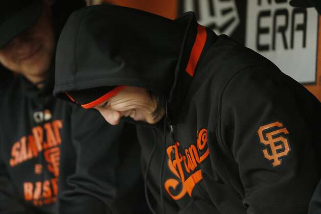 Tim Lincecum laughs in the dugout with his teammates in the bottom of the second inning as the San Francisco Giants play the Arizona Diamondback at AT&T Park in San Francisco Calif, on Wednesday, May 11, 2011. Photo: Alex Washburn, The Chronicle
