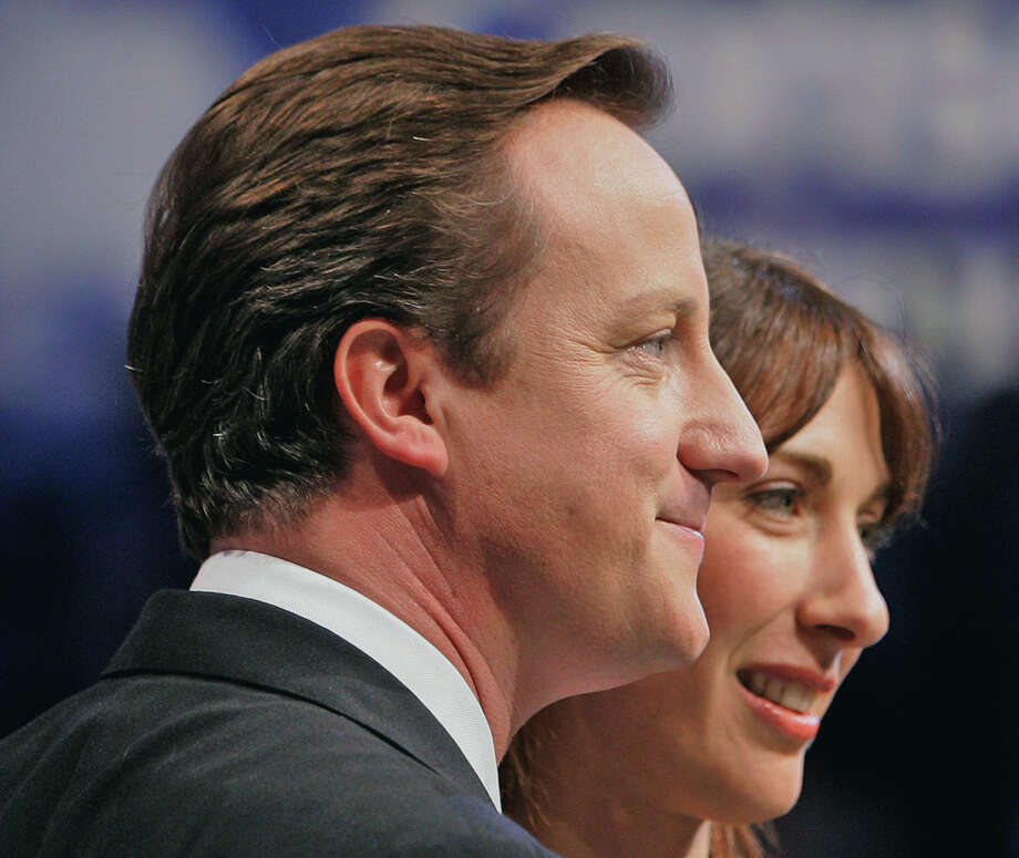 FILE This Wednesday, Oct. 3, 2007 file photo shows David Cameron, leader of Britain's opposition Conservative Party  with his wife Samantha, after he delivering his keynote speech on the last day of the annual Conservative Party conference in Blackpool, England. British Prime Minister David Cameron's office confirmed Monday June 11, 2012 that the prime minister accidentally left his 8-year-old daughter Nancy in a pub after a family Sunday lunch near his country home, west of London. They said the incident happened a few months ago as the family was leaving the pub. Cameron was travelling in one car with his bodyguards and assumed that Nancy was in the other car with his wife Samantha and two other children. Samantha assumed the child was with her father and only realized she was missing when they got home.(AP Photo/Kirsty Wigglesworth, File) Photo: Kirsty Wigglesworth / AP