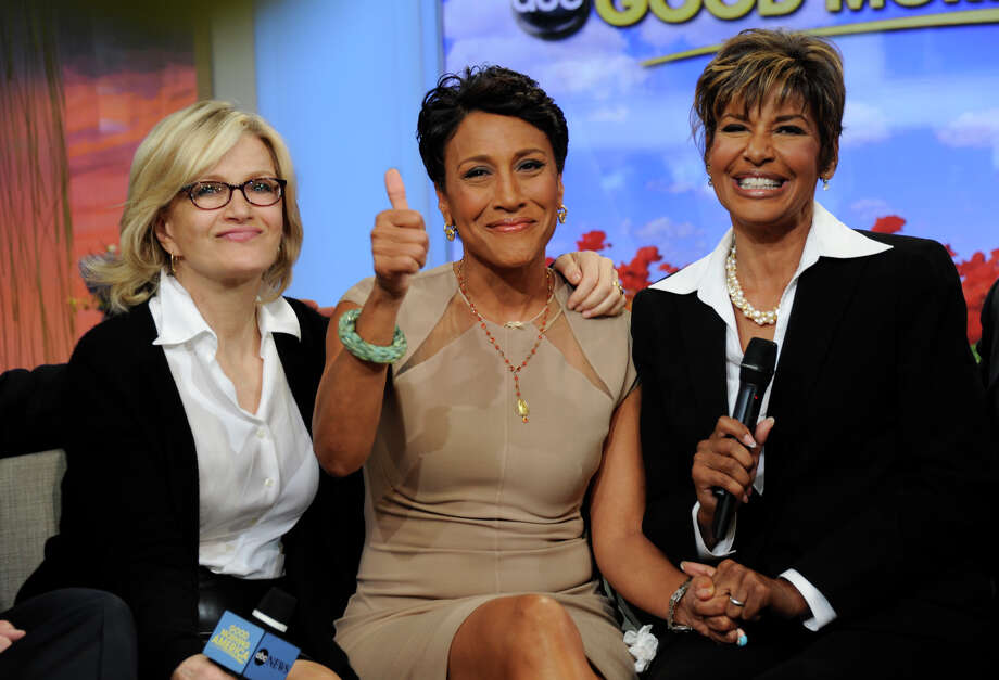 """Robin Roberts, center, with her sister Sally Ann Roberts, and ABC News' Diane Sawyer on """"Good Morning America"""" Monday, announced she has been diagnosed with myelodysplastic syndrome, a blood and bone marrow disease. Photo: Ida Mae Astute / ©2012 American Broadcasting Companies, Inc.  All rights reserved."""