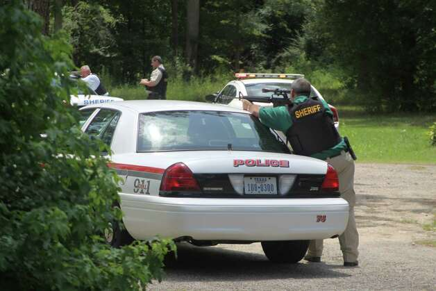 Deputies take position at a home at 1330 Villa Road in Kountze on Monday, June 11 after a woman shot her relative and then held officers at bay with a loaded shotgun. The standoff lasted for over six hours before the woman was taken into custody. Photo: David Lisenby