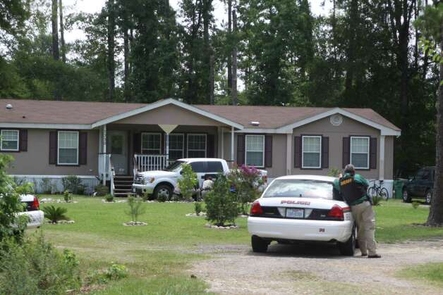 Deputies surround a home at 1330 Villa Road in Kountze on Monday, June 11 after a woman shot her relative and then held officers at bay with a loaded shotgun. The standoff lasted for over six hours before the woman was taken into custody. Photo: David Lisenby