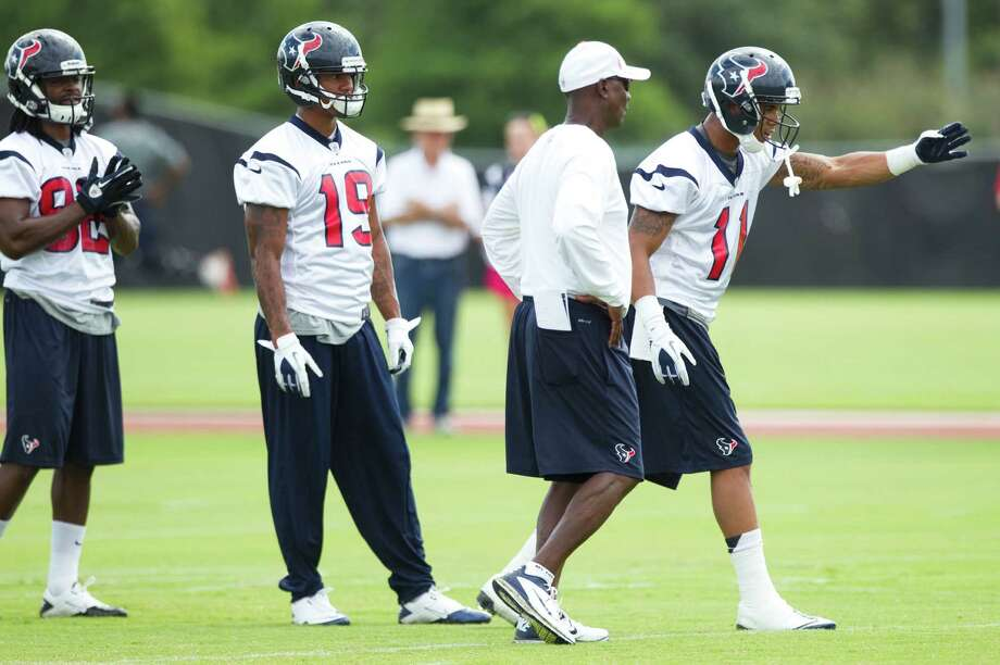 Texans receivers Keshawn Martin (82), Juaquin Iglesias (19) and DeVier Posey (11) will see plenty of receivers coach Larry Kirksey over the next three days. Photo: Brett Coomer / © 2012 Houston Chronicle