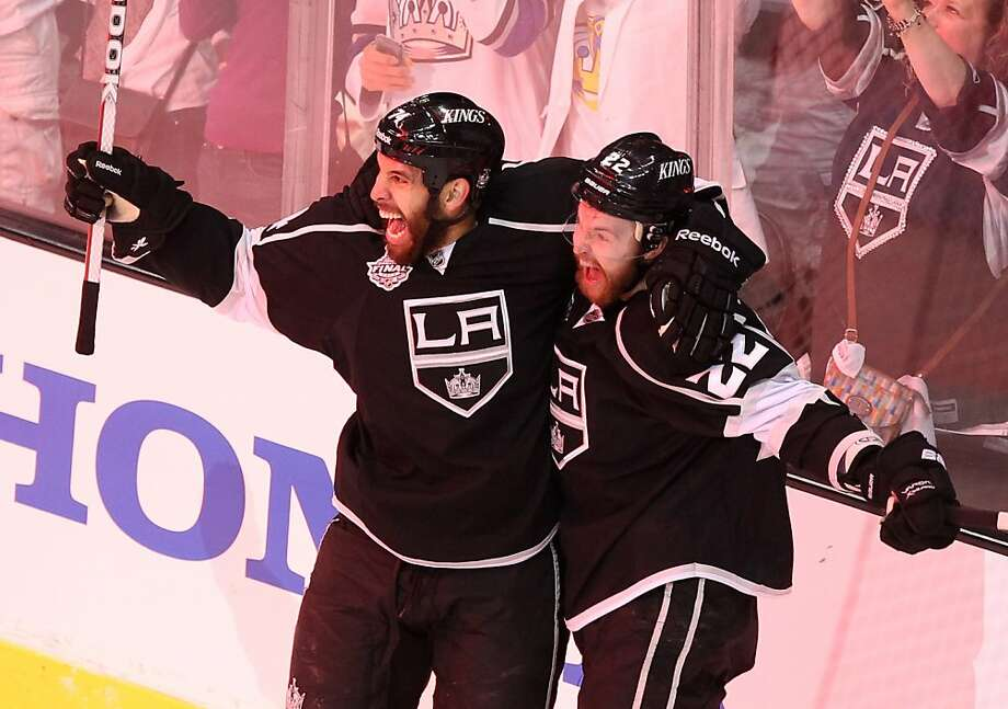 LOS ANGELES, CA - JUNE 11:  Trevor Lewis #22 and Dwight King #74 of the Los Angeles Kings celebrate after Lewis scored the Kings' third goal in the first period of Game Six of the 2012 Stanley Cup Final against the New Jersey Devils at Staples Center on June 11, 2012 in Los Angeles, California.  (Photo by Christian Petersen/Getty Images) Photo: Christian Petersen, Getty Images