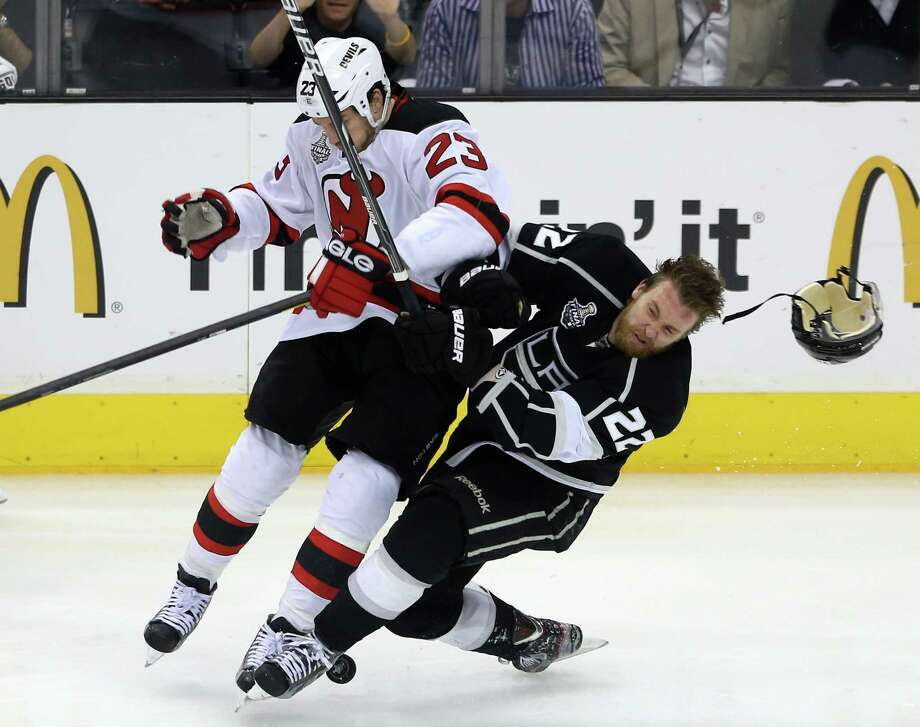 David Clarkson of the New Jersey Devils nails Trevor Lewis. (AP) Photo: Bruce Bennett, Getty Images / 2012 Getty Images
