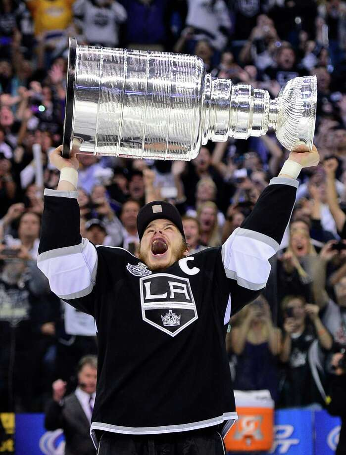 Kings 6, Devils 1American star and Los Angeles Kings captain Dustin Brown is the first to get the Cup.(AP Photo/Mark J. Terrill) Photo: Mark J. Terrill, Associated Press / AP