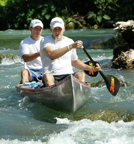 Brad Ellis, 30, front, and Ian Rolls, 34,  paddle through Cottonseed Rapids in Martindale, after the start of the 2012 Texas Water Safari.  Ellis died Monday at Brooke Army Medical Center in San Antonio. Photo: Erich Schlegel / © 2012 Erich Schlegel