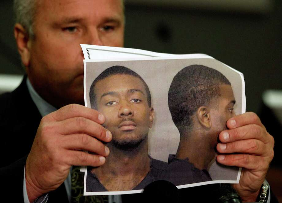 Auburn Police Chief Tommy Dawson holds up a photo of Desmonte Leonard, 22, of Montgomery, Ala., the suspect wanted for fatally shooting three people, including two former Auburn University football players, and wounding another three people during a party at an apartment complex near the school, at a news conference Sunday, June 10, 2012, in Auburn, Ala. Dawson said that current football player Eric Mack was among those wounded and was being treated at a hospital. The two slain former players were identified as Edward Christian and Ladarious Phillips. The other person killed was identified as Demario Pitts. (AP Photo/David Goldman) Photo: David Goldman / AP