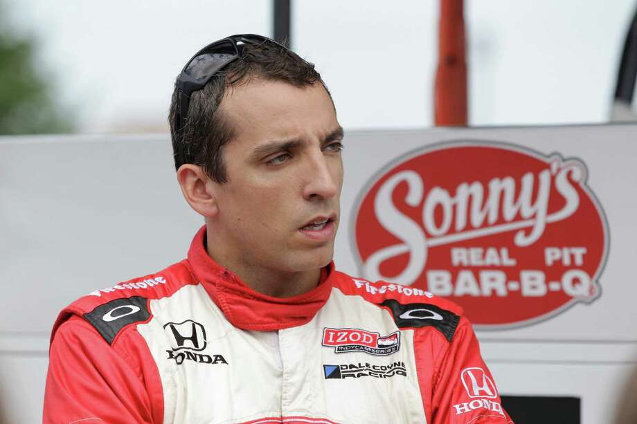 IndyCar driver Justin Wilson of Britain talks to his crew after practice laps for the Detroit Grand Prix auto race on Belle Isle in Detroit, Sunday, June 3, 2012. (AP Photo/Carlos Osorio) Photo: Carlos Osorio / AP