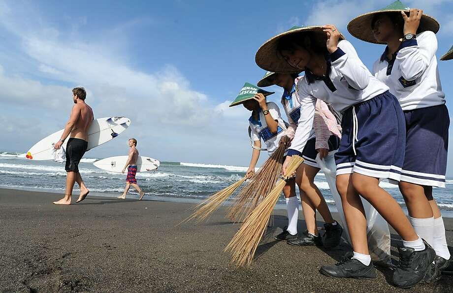 Children from a local secondary school take part in a mass beach clean up at the world famous Echo beach surfing spot, Perenenan village in Bali on June 12, 2012.  The association responsible; Gumi Lestari, is running a pioneering project to get the local community involved in protecting the environment. Bali, one of the world's top surf spots has a huge problem with rubbish collection and disposal with the majority of the tonnes of rubbish created per day coming from tourism.    AFP PHOTO/MIKE CLARKEMIKE CLARKE/AFP/GettyImages Photo: Mike Clarke, AFP/Getty Images