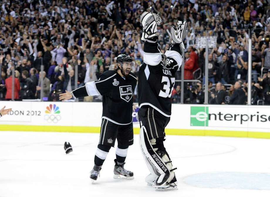 LOS ANGELES, CA - JUNE 11:  Drew Doughty #8 and Jonathan Quick #32 of the Los Angeles Kings celebrate the Kings 6-1 victory as they win the Stanley Cup in Game Six of the 2012 Stanley Cup Final at Staples Center on June 11, 2012 in Los Angeles, California.  (Photo by Harry How/Getty Images) Photo: Harry How, Getty Images / 2012 Getty Images