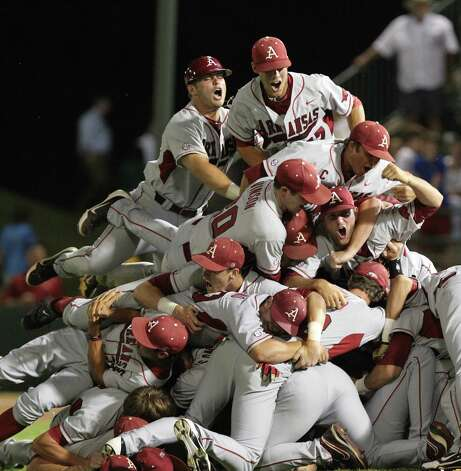 Arkansas players celebrate after defeating Baylor in the 10th inning of an NCAA college baseball tournament super regional game, Monday, June 11, 2012, in Waco. Photo: AP Photo/Waco Tribune Herald, Jerry Larson