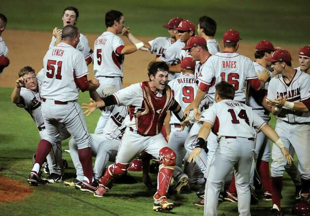 Arkansas players celebrate after defeating Baylor 1-0 after their NCAA college baseball tournament super regional game, Monday,  June 11, 2012, in Waco. Photo: AP Photo/Waco Tribune Herald, Rod Aydelotte