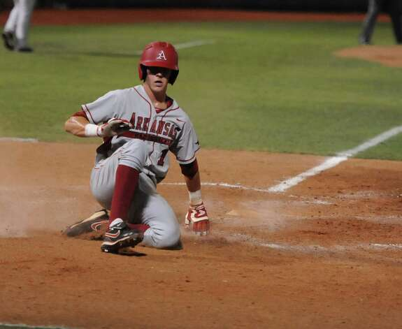 Arkansas' Brian Anderson (1) scores against Baylor in the 10th inning of an NCAA college baseball tournament super regional game, Monday,  June 11, 2012, in Waco. Photo: AP Photo/Waco Tribune Herald, Rod Aydelotte