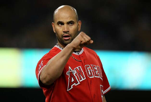 LOS ANGELES, CA - JUNE 11:  Albert Pujols #5 of the Los Angeles Angels of Anaheim celebrates in the middle of the ninth inning after his battin in the go ahead run with a single against the Los Angeles Dodgers on June 11, 2012 at Dodger Stadium in Los Angeles, California.  Teh Angels won 3-2.  (Photo by Stephen Dunn/Getty Images) Photo: Stephen Dunn, Getty Images