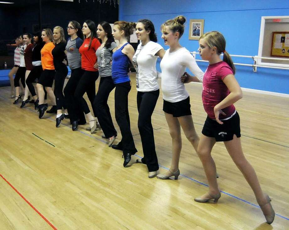 """The Rockette-style cast of """"Tis the Season"""" practices for their holiday show on Wednsday Nov. 11, 2009 at Dance Etc. Dance school in Newtown, CT. The show will serve as a fundraiser for Anne's Place and the New MIlford Food Bank. Photo: Lisa Weir / The News-Times"""