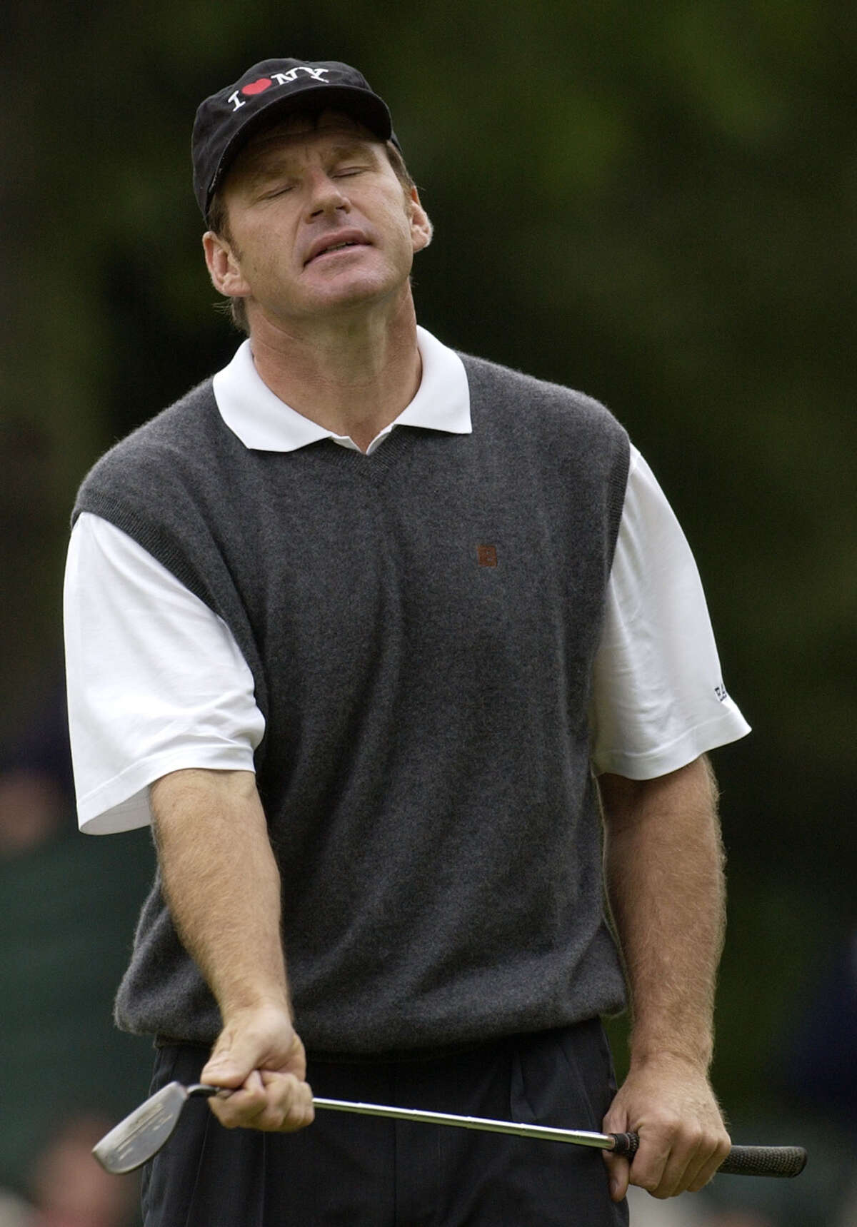 FILE-This June 15, 2002 file photo shows Nick Faldo reacting after missing a birdie putt on the second green during the third round of the U.S. Open Golf Championship at the Black Course of Bethpage State Park in Farmingdale, N.Y. Always a thinker, Faldo was looking for the secret to winning when he met with Ben Hogan and asked him what it takes to win the U.S. Open.