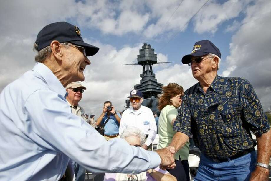 Julio Zaccagni (left) and Don Cade, both former Battleship TEXAS crew members, share a laugh during the 2011 USS TEXAS Veteran's Reunion at the Battleship TEXAS State Historic Site, Saturday, Oct. 8, 2011, in LaPorte. (Michael Paulsen / Houston Chronicle)