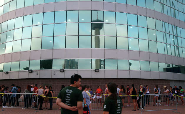 People stand in line at the Alamodome early Tuesday June 12, 2012 to register for auditions for the next American Idol competition. The actual auditions for the show take place this coming Thursday. Photo: San Antonio Express-News