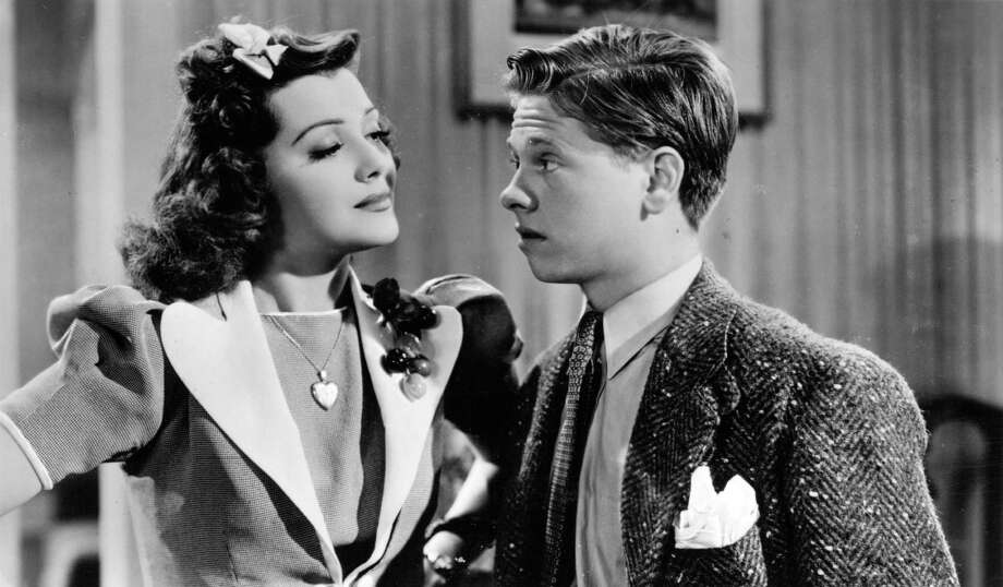 circa 1936:  Mickey Rooney (1920 - ) the Hollywood child actor with Ann Rutherford (1917 - ) viewed in a film clip on a postcard. Photo: Hulton Archive, Getty Images / Hulton Archive