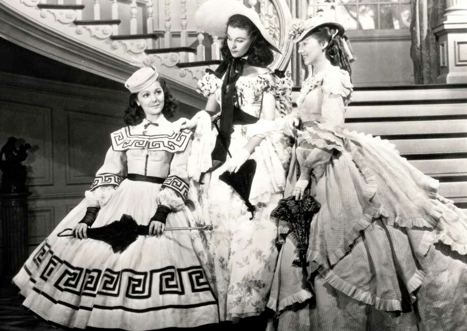 """This undated image from the film """"Gone with the Wind"""" provided by New Line Cinema shows, from left, Ann Rutherford, Vivien Leigh and Evelyn Keyes. Rutherford, who played Scarlett O'Hara's sister Carreen in the 1939 movie classic """"Gone With the Wind,"""" died at her home in Beverly Hills, Calif. on Monday, June 11, 2012.  She was 94.  (AP Photo/New Line Cinema) Photo: Anonymous, Associated Press / AP2009"""