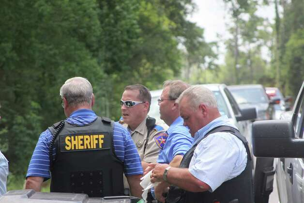 Deputies take position at a home at 1330 Villa Road in Kountze on Monday, June 11 after a woman shot her relative and then held officers at bay with a loaded shotgun. The standoff lasted for over six hours before the woman was taken into custody. Photo: David Lisenby, HCN_Standoff