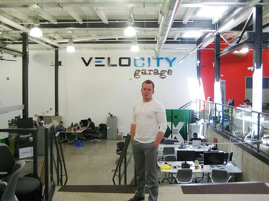 "16. Waterloo, Ontario: ""In the near future, it will be interesting to see whether Waterloo is able to hold on to its talent base or whether it will be sucked into Toronto."" In this May 10, 2012 photo, Stephen Lake from Playfit Mobile stands in the University of Waterloo's VeloCity incubation startup area. Photo: Robert Gillies, Associated Press"