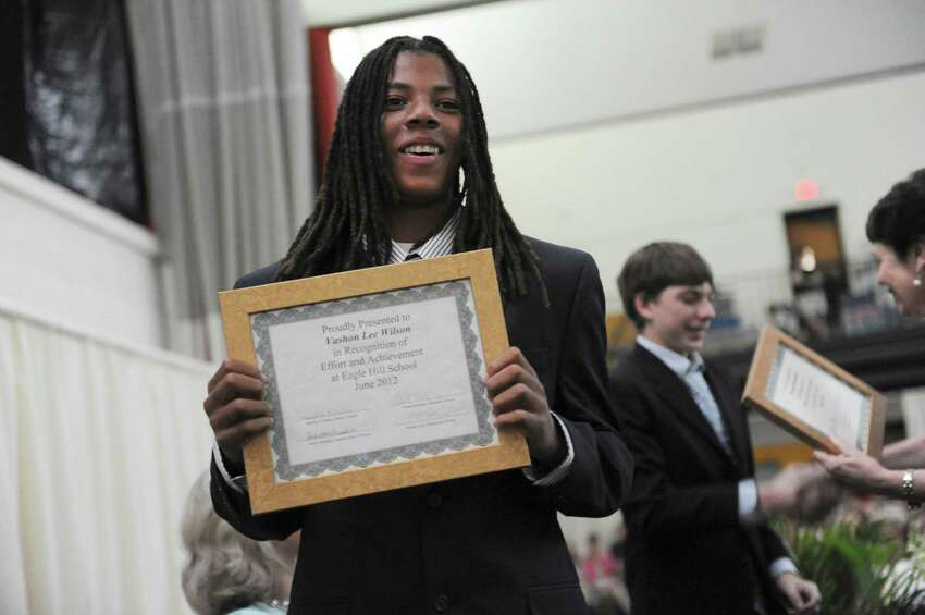 Vashon Lee Wilson holds his diploma at the Eagle Hill School graduation Sunday, June 10, 2012. Eagle Hill School is a boarding and day school in Greenwich for children with learning disabilities.