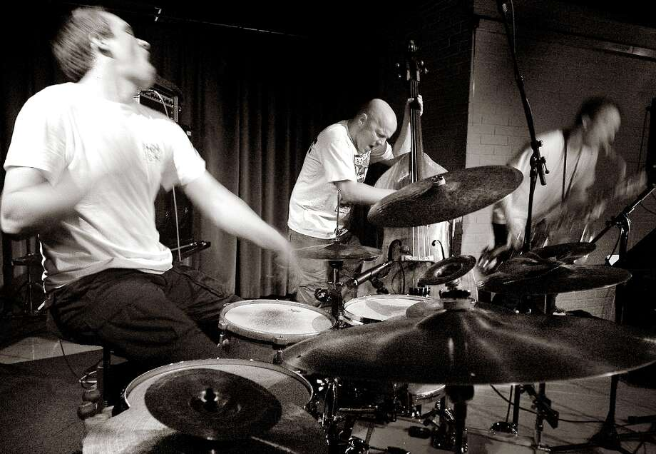 The Thing, the Scandinavian free jazz/etc. group, is staffed by Mats Gustafsson (right, reeds, woodwinds, electronics), Paal Nilssen-Love (left, drums, percussion) and Ingebrigt Haker Flaten (upright bass). Photo: Ziga Koritnik, Courtesy Photo