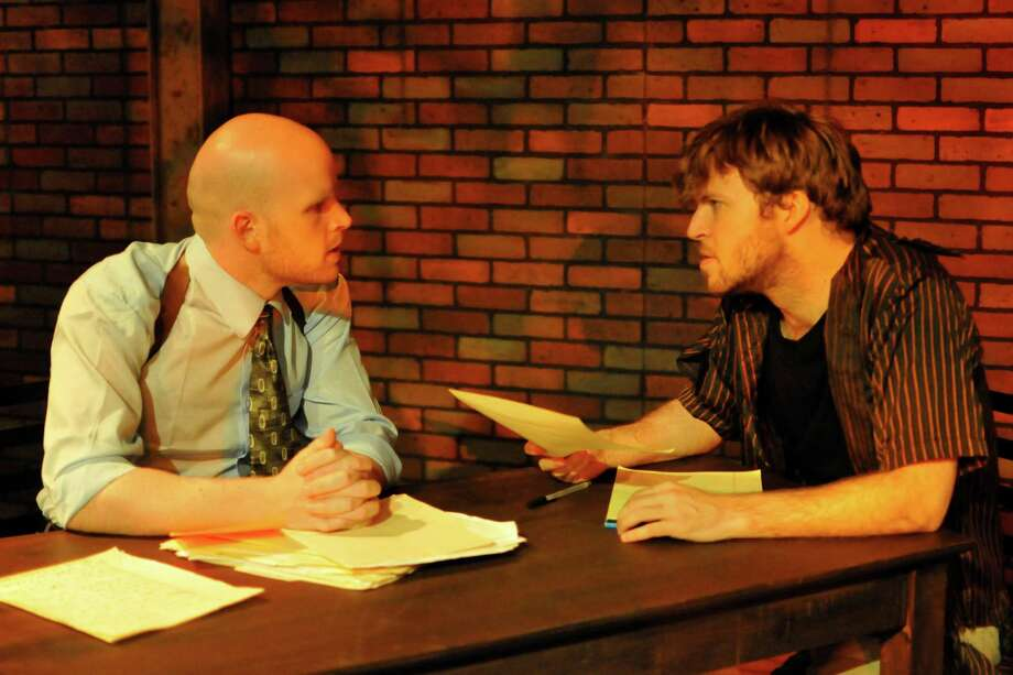 "Tyler Keyes (from left) and Michael Burger play a cop and a writer in the Woodlawn Black Box Theatre's ""The Pillowman."" Courtesy Sandra Trevino"
