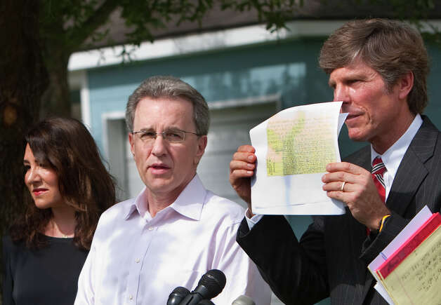 Yvonne Stern, left, stands with her husband Jeffrey Stern, center, and his attorney, Paul Nugent, right, as he holds up written by Michelle Gaiser during a press conference at their home Tuesday, June 12, 2012, in Houston. Stern is due to stand trial after he was accused of trying to have his wife killed. Photo: Cody Duty, Houston Chronicle / © 2011 Houston Chronicle