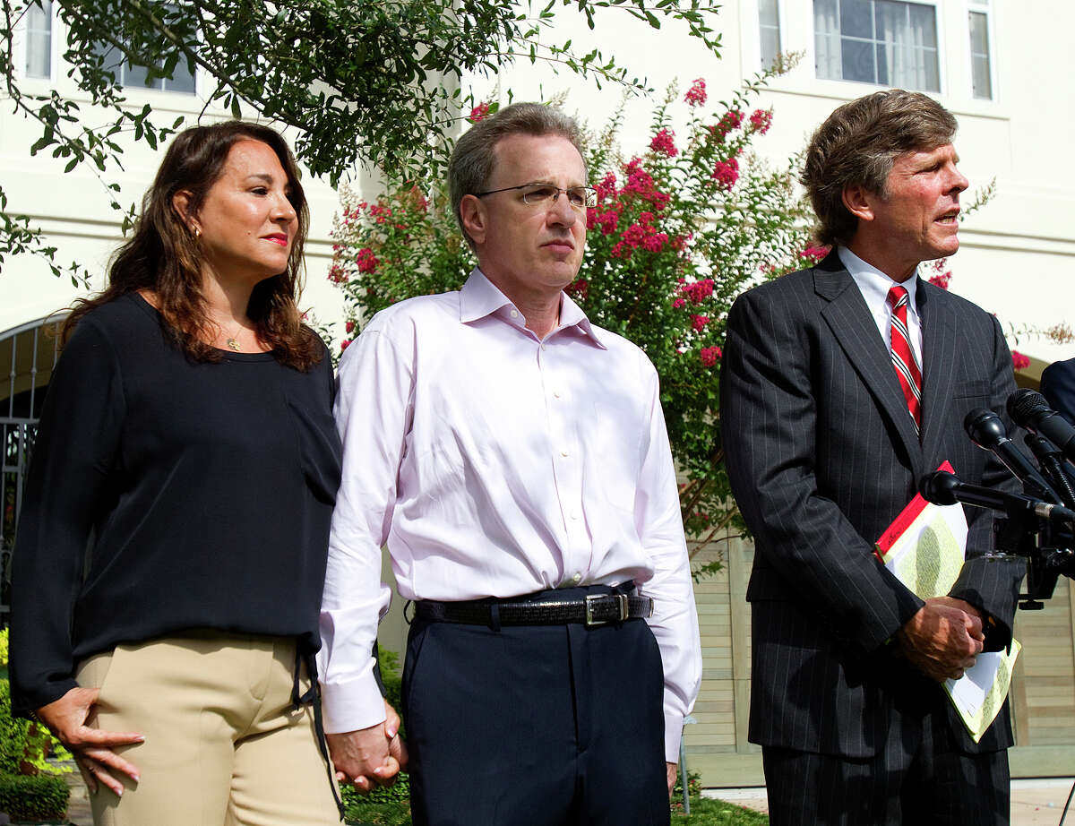 Yvonne Stern, left, stands with her husband Jeffrey Stern, center, and his attorney, Paul Nugent during a press conference at their home Tuesday, June 12, 2012, in Houston. Stern is due to stand trial after he was accused of trying to have his wife killed.