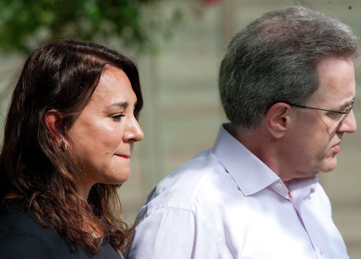 Yvonne Stern, left, stands with her husband Jeffrey Stern during a press conference at their home Tuesday, June 12, 2012, in Houston. Stern is due to stand trial after he was accused of trying to have his wife killed.