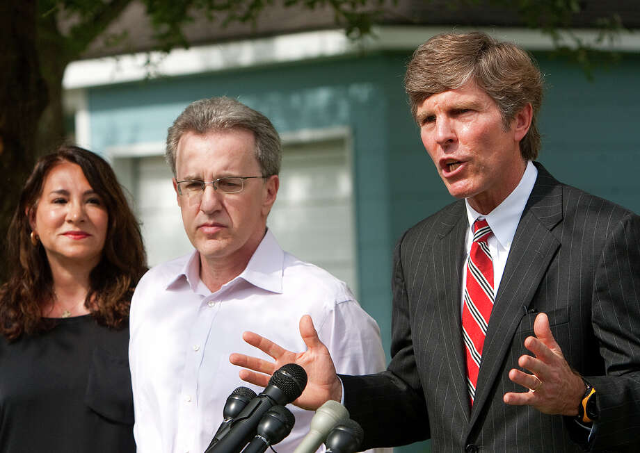 Yvonne Stern, left, stands with her husband Jeffrey Stern, center, and his attorney, Paul Nugent during a press conference at their home Tuesday, June 12, 2012, in Houston. Jeffrey Stern is due to stand trial after he was accused of trying to have his wife killed. Nugent said a new 