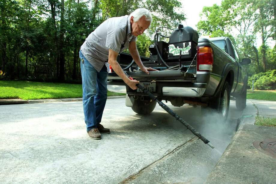 Paul Culbertson, of the Montgomery County Pct. 3 Commissioners Office, sprays a storm drain to fight mosquitoes in The Woodlands. Recent testing in south Montgomery County revealed the presence of West Nile virus. Photo: Brett Coomer / © 2012 Houston Chronicle
