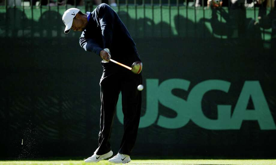 Tiger Woods hits a drive on the seventh hole during a practice round for the U.S. Open Championship golf tournament Tuesday, June 12, 2012, at The Olympic Club in San Francisco. (AP Photo/Charlie Riedel) Photo: Charlie Riedel, Associated Press / AP