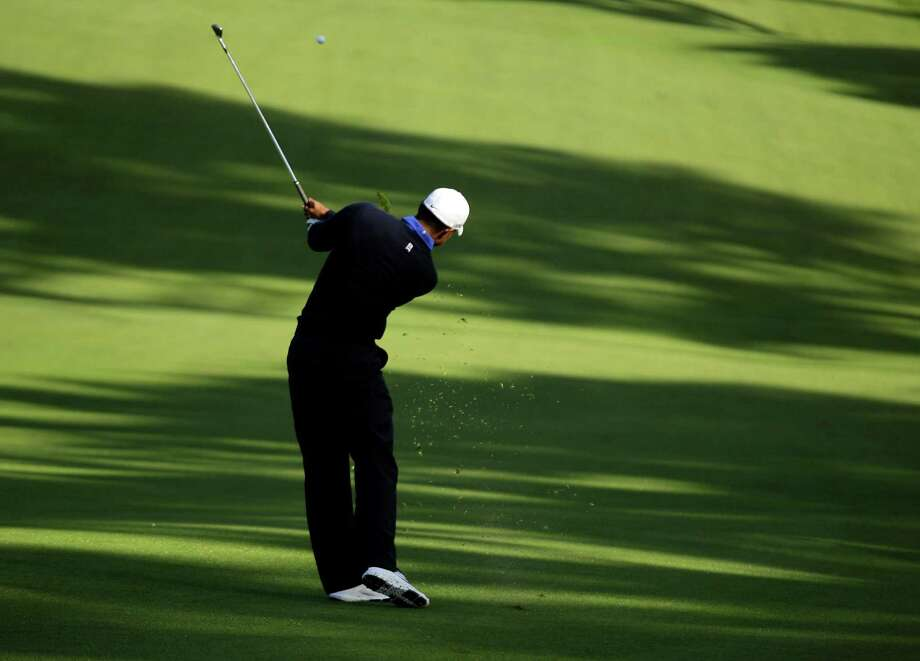 Tiger Woods hits a shot during a practice round for the U.S. Open Championship golf tournament Tuesday, June 12, 2012, in San Francisco. (AP Photo/Charlie Riedel) Photo: Charlie Riedel, Associated Press / AP