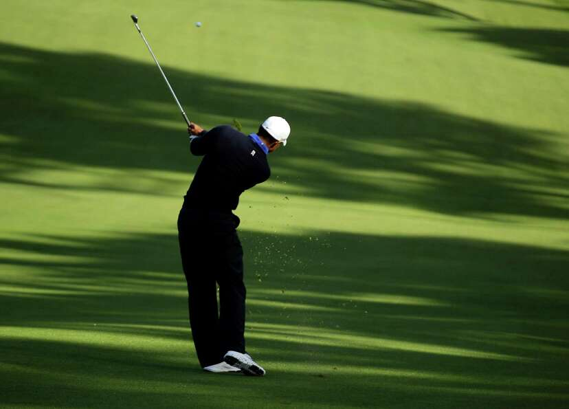Tiger Woods hits a shot during a practice round for the U.S. Open Championship golf tournament Tuesd