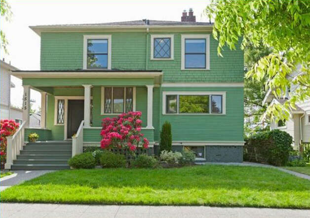 Last month we featured contemporary homes in Queen Anne for up to $850,000. Now, we go back to the classic neighborhood's specialty: big, early 20th Century Craftman houses. We start with 1515 1st Ave. N. The 2,644-square-foot house, built in 1907, has four bedrooms, 1.75 bathrooms, a formal entry, inlaid hardwood floors, pocket doors, a gas fireplace, a front porch and a back deck over a two-car garage on a 6,000-square-foot lot. It's listed for $850,000. Photo: Courtesy Randie Nelson/Windermere Real Estate