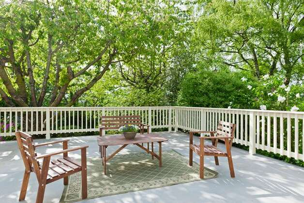 Back deck over two-car garage of 1515 1st Ave. N. The 2,644-square-foot house, built in 1907, has four bedrooms, 1.75 bathrooms, a formal entry, inlaid hardwood floors, pocket doors, a gas fireplace, a front porch and a back deck over a two-car garage on a 6,000-square-foot lot. It's listed for $850,000. Photo: Courtesy Randie Nelson/Windermere Real Estate