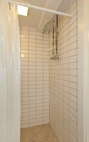 Three-quarter bathroom of 1515 1st Ave. N. The 2,644-square-foot house, built in 1907, has four bedrooms, 1.75 bathrooms, a formal entry, inlaid hardwood floors, pocket doors, a gas fireplace, a front porch and a back deck over a two-car garage on a 6,000-square-foot lot. It's listed for $850,000. Photo: Courtesy Randie Nelson/Windermere Real Estate